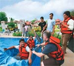 Twisting by the pool: Qualcomm team leaders set sail with a cardboard boat at Hyderabad's Golconda Resorts